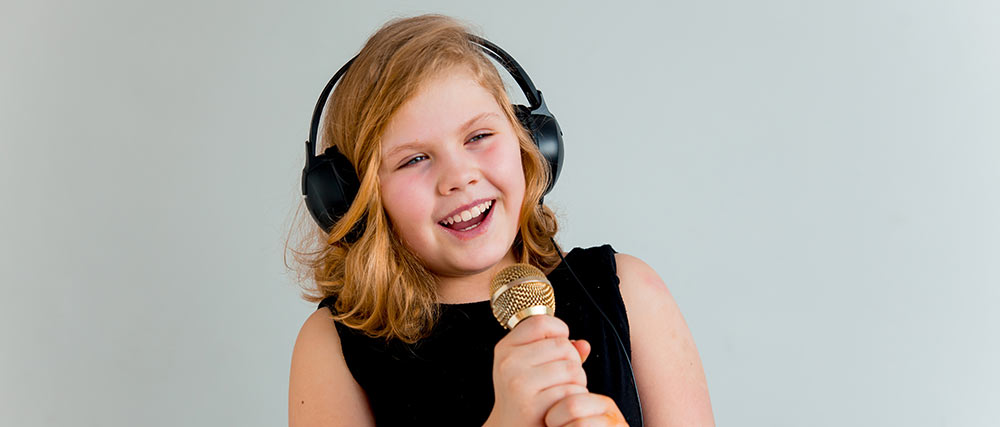 Young girl singing her favourite song