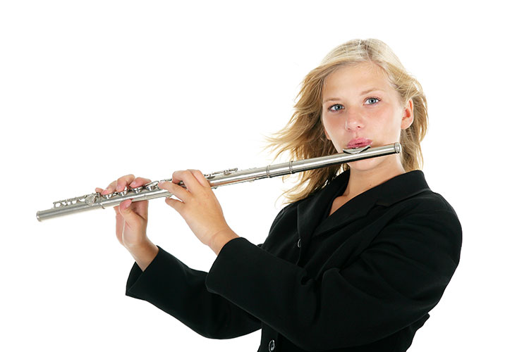 Teenager playing the flute