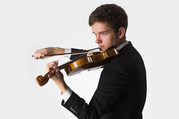 Teenager playing the violin