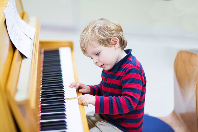 Toddler learning to play the piano