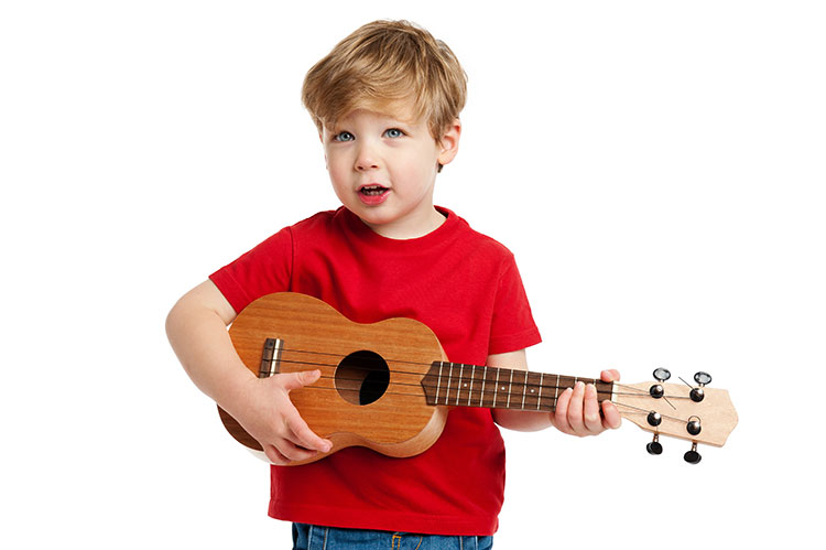 Toddler playing guitar
