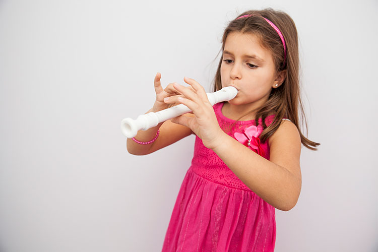 Toddler playing the recorder