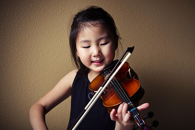 Toddler playing the violin