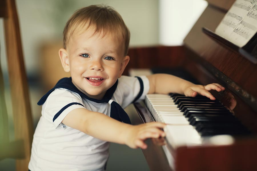 Very young baby playing the piano