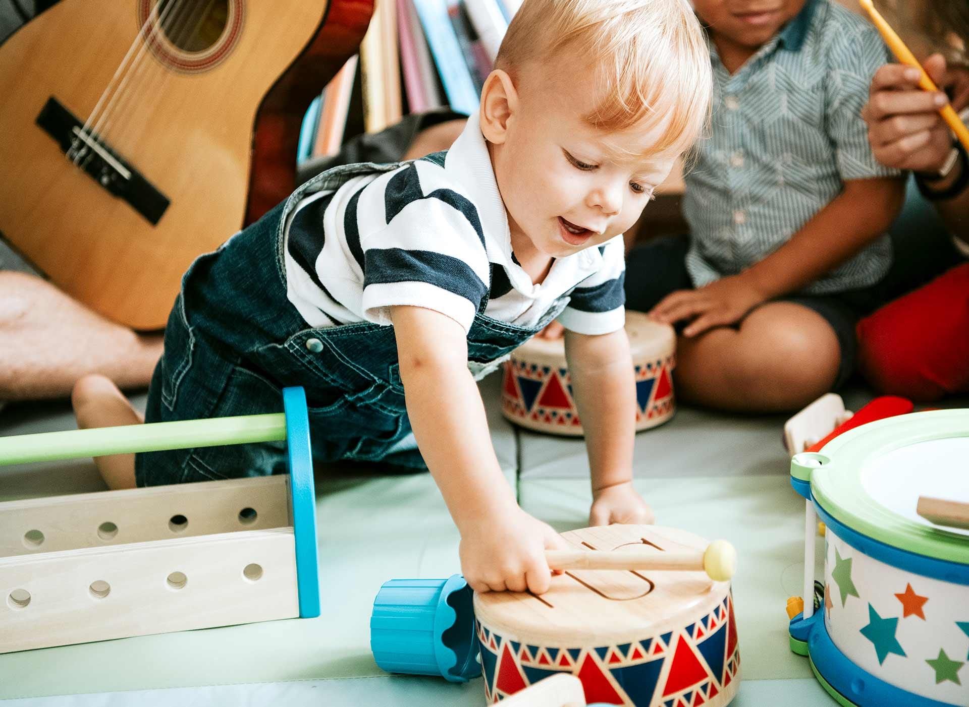 Toddler playing a drum