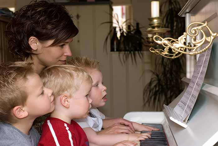 Family playing the piano