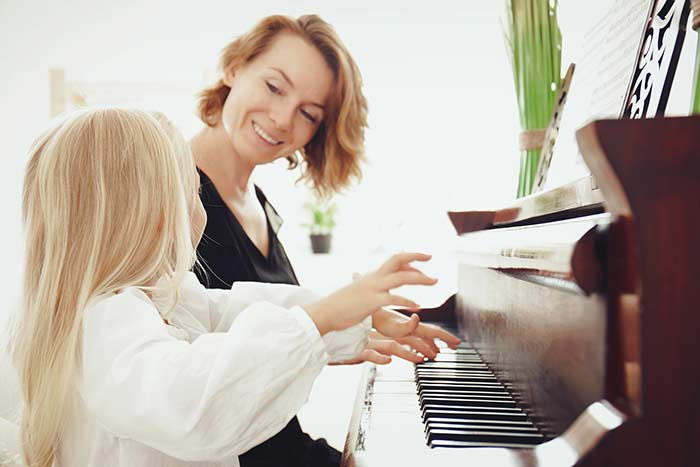Mum and daughter at the piano