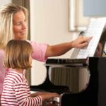 Piano teacher and little girl