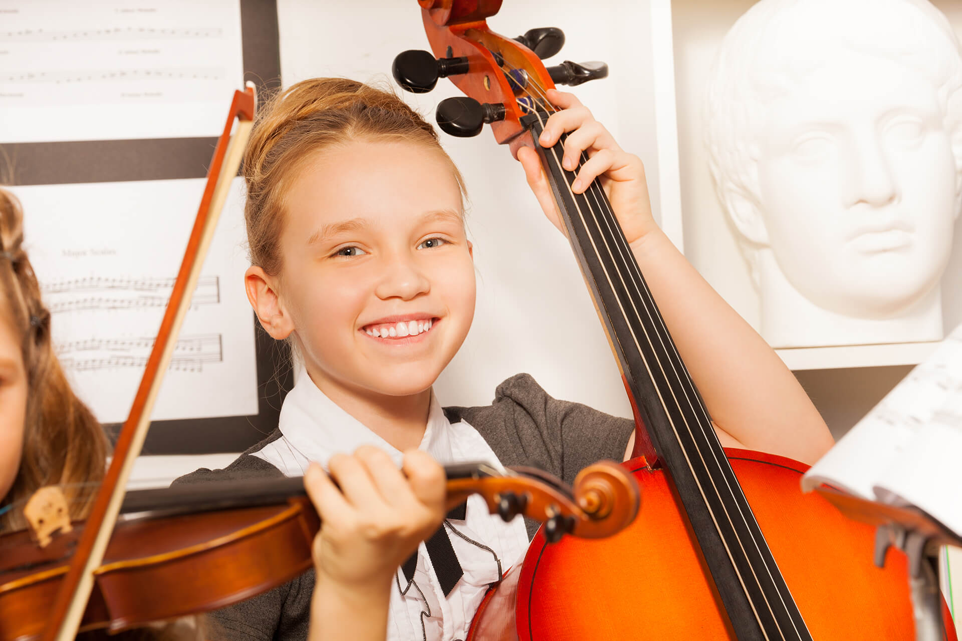 Young girl playing the cello
